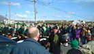 Band marching with Shamrock man - 52KB