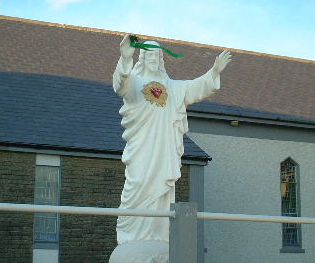 Statue of Jesus wearing shamrock